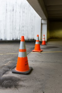 cones in a parking garage - one