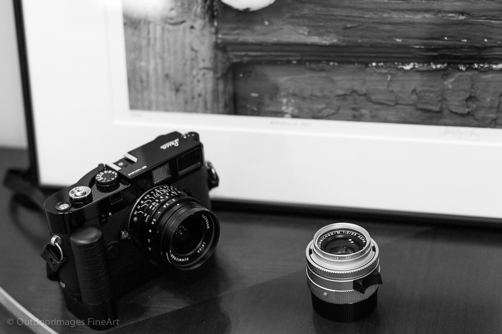 Leica film camera with winder and Summicron 28mm, Summicron 35mm lenses.